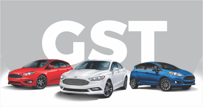 Three Models of Car Displayed On Isolated Text Background GST - GST Concept.